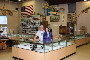 Merton Larmore III, with his wife, Dawn Larmore, are getting the jewelry display cases ready for opening day. Litchfield County Pickers South will carry an extensive collection of fine jewelry and costume jewelry at the store. Alicia Sakal/ Republican-American