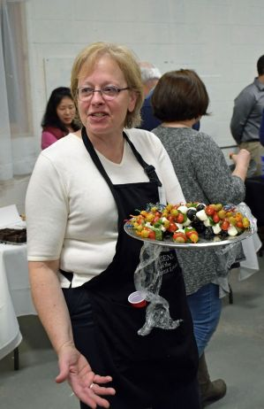 Friends of the Bakerville Library member Joan Auclair serves hors d'oeuvres Saturday night during the library's annual Perfect Pair fundraiser, which invited patrons to enjoy chocolate in various forms and a variety of wines. Kathryn Boughton/Republican-American