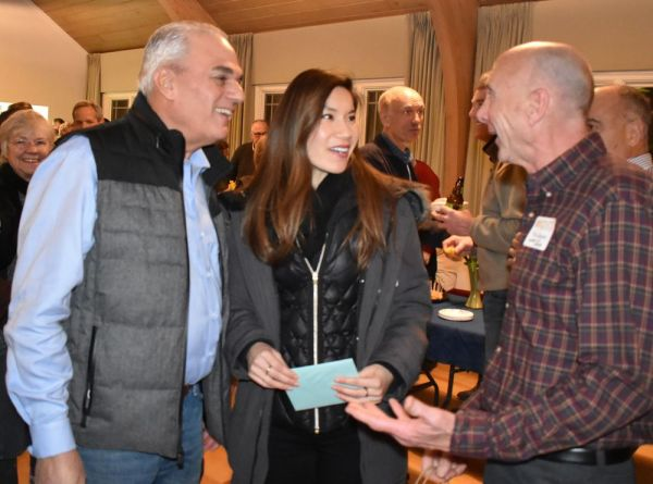 Photos by Lynn Mellis Worthington Republican-American Steve and May Raitmano congratulate Tim Groski, right, who retired in December as a UPS driver after delivering packages in Kent for 32 years.