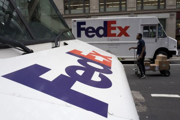 FILE - This Aug. 22, 2017 file photo shows FedEx trucks parked in New York. Companies with ties to the National Rifle Association have been dealing with increasing public pressure since the Parkland, Florida massacre that killed 17 people earlier this month. FedEx is the latest company prompted to make a statement, saying it þÄúopposes assault rifles being in the hands of civiliansþÄù but strongly supports the right to own a firearm. The delivery service, which offers discounts to NRA members, said it is sticking with the organization. (AP Photo/Mark Lennihan, File)
