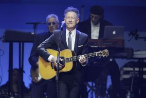 Associated Press Lyle Lovett performs during a hurricanes relief concert in College Station, Texas, in , Oct. 2017.     All five living former U.S. presidents joined to support a Texas concert raising money for relief efforts from Hurricane Harvey, Irma and Maria's devastation in Texas, Florida, Puerto Rico and the U.S. Virgin Islands. (AP Photo/LM Otero)
