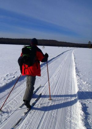 Skiing Across Long Pond. While our wives caught a snowmobile shuttle back to the cars, my new friend John and I chose to ski across Long Pond on a cold, still morning. (Tim Jones/EasternSlopes.com photo)