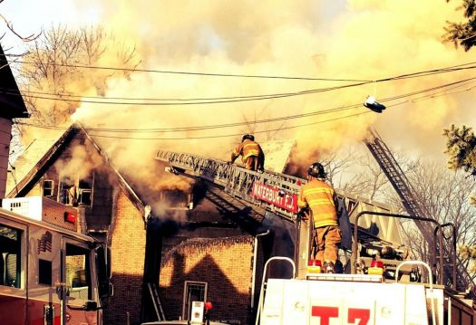 WATERBURY -- March 1 -- 28_NEW_030118MDP01 -- Firefighters battle a blaze at 76 High Street Wednesday morning.