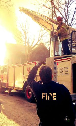 WATERBURY -- March 1 -- 28_NEW_030118MDP02 -- Firefighters were ordered to evacuate a burning house at 76 High Street Wednesday morning.