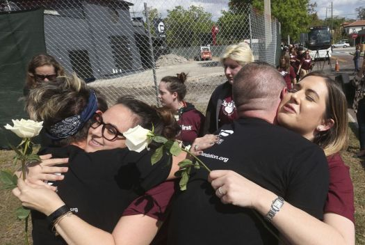 Parents and students of Marjory Stoneman Douglas High School receive a welcome as they stop at the Pulse night club, Wednesday in Orlando, Fla. Red Huber/Orlando Sentinel via AP