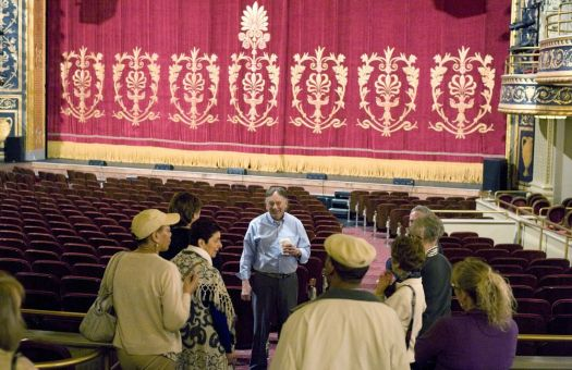 WATERBURY, CT-030218JS09--Palace Theater historian Lou Belloisy, center, talks with guests during a tour of the theater on the first of a five-week class that explores the history of the Palace Theater in Waterbury, including its architecture and the talent that has graced its stage. Another class will be available in the fall.   Jim Shannon Republican-American
