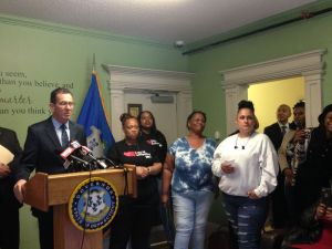 Gov. Dannel P. Malloy promotes a new bill aimed at improving the state's sole prison for women during a news conference at a Hartford halfway house on Tuesday. To the governor's right stand a group of women who had been incarcerated at the Niantic prison. Josie Albertson-Grove/Republican-American