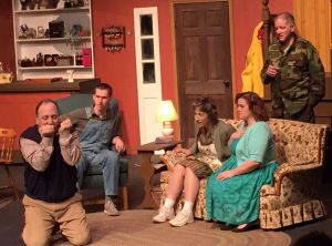 Cast members perform a scene from 'The Foreigner,' playing at the Phoenix Stage Company in Oakville through March 31. Contributed