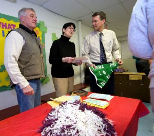From left, Fran DuCotey, Cheryl Kloczko and Northwestern Connecticut YMCA CEO Greg Brisco talk about some of the items they removed during the opening of a 50-year time capsule Friday in Torrington. DuCotey and Kloczko both put items in the capsule in 1968. Jim Shannon Republican-American