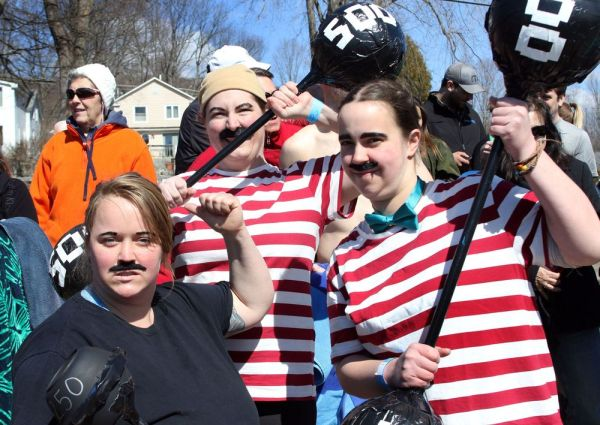Photos by Steven Valenti Republican-American From left, Bri Torneo, Ali Cierocki and Shannon Lindau have their game faces and costumes on before hitting the water at the Penguin Plunge fundraiser for Special Olympics Connecticut at Highland Lake in Winsted on Saturday.
