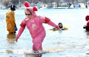 Sue DiCara of Winsted takes the plunge during the Penguin Plunge fundraiser for Special Olympics Connecticut at Highland Lake in Winsted on Saturday. DiCara does it to honor her late niece, who was a marine biologist.