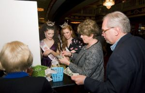 Volunteers from left, WATR's Barbara Davitt; Miss Greater Waterbury's Outstanding Teen Lindiana Frangu, Miss Greater Waterbury Danielle Radeke, Marybeth Chute and her husband WATR's Tom Chute sort donations to benefit the Greater Waterbury Campership Fund they collected Saturday during intermission of Jersey Boys at the Palace Theater in Waterbury. Jim Shannon Republican-American