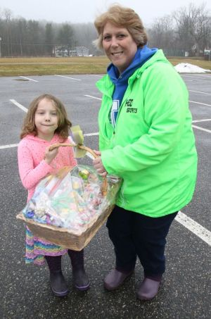 Lisa Beyer, right, assistant director of the Litchfield Parks and Recreation Department, stands with Cadence Eterginio, winner of the town's Easter egg hunt candy-guessing contest on Friday.