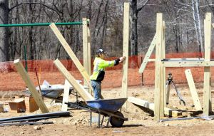 Work crews build and install new playground equipment at Hollow Park in Woodbury Monday. Steven Valenti Republican-American
