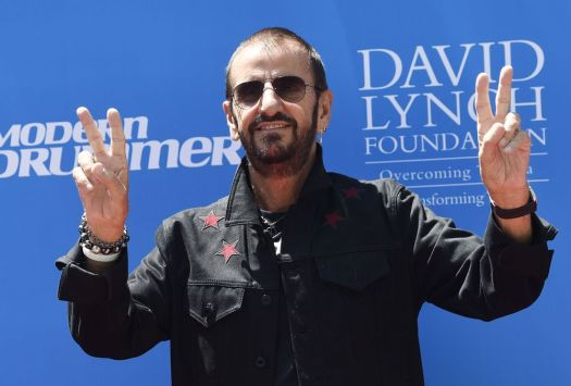 Ringo Starr flashes the peace sign for photographers during a 77th birthday celebration for him at Capitol Records on Friday, July 7, 2017, in Los Angeles. (Photo by Chris Pizzello/Invision/AP)