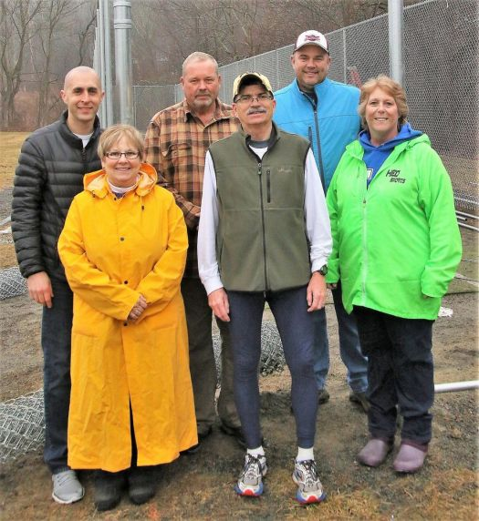 Litchfield Parks and Recreation Department Director Brent Hawkins, center in the front row, with Parks and Recreation Commission members, from left, Gianni Perugini, Lisa Bauer, Ray Schmid and Rob Gollow, and Parks and Recreation assistant Lisa Beyer at the new batting cage at Community Field. John McKenna Republican-American