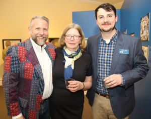 Litchfield Historical Society Executive Director Cathy Fields, center, with the historical society's curator of collections, Alex Dubois, right, and Bob Burns, executive director of the Mattatuck Museum in Waterbury, during the opening of the historical society exhibit. John McKenna Republican-American