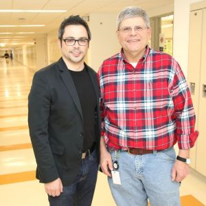 Architect Marc Moura, left, returned to Litchfield High School to discuss his career and visit with one of his old teachers, Neil English. John McKenna Republican-American
