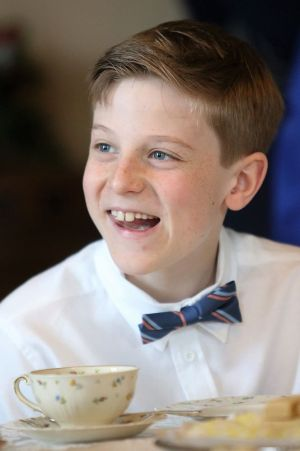 Josh De Lello, a sixth-grader at James Morris School in Morris, chats with a classmate during the annual sixth-grade tea on Thursday the Aline Brothier Morris Reading Room. John McKenna Republican-American