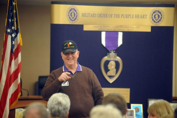 Daniel M. Eddinger, state commander of the Military Order of the Purple Heart, talks to Purple Heart recipients and their family members about designating Torrington as a 'Purple Heart City.' Many Purple Heart recipients, their family members and Gold Star families spoke Thursday at Torrington City Hall. Bruno Matarazzo Jr. Republican-American