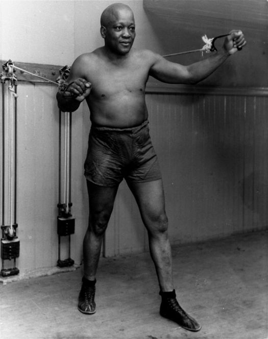 Boxer Jack Johnson is shown working out in New York City in this 1932 file photo at the age of 54. Asociated Press