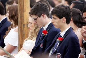 WASHINGTON CT. 28 May 2018-052818SV04- From left, Twins Carter and Brett Matthews, both 18 of Washington listen to speakers during the graduation ceremony at The Gunnery School in Washington Monday. Steven Valenti Republican-American