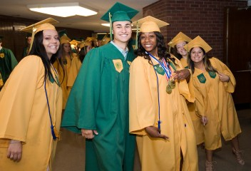 WATERBURY, CT-060218JS01-- Graduating student Meghan Booth, Richard Blanco and Meah Austin, pose for a photo prior to graduation ceremonies Sunday at Holy Cross High School. Jim Shannon Republican American