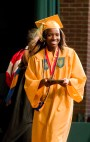 WATERBURY, CT-060218JS05-- Holy Cross graduate Solomon Darko makes her way across the stage after receiving her diploma during graduation ceremonies Sunday at Holy Cross High School. Jim Shannon Republican American
