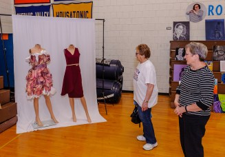 WOODBURY, CT. 07 June 2018-060718BS570 - Woodbury residents Joanne Milo, left, and Jackie Haeusgen look at the dresses done in paper by the students of region 14 at Nonnewaug High School on Thursday afternoon. Bill Shettle Republican-American