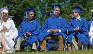 Shepaug Valley School graduates share a light moment during commencement Saturday morning in Washington, Conn. Michael Kabelka / Republican-American