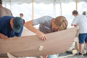 Participants in the Family Boat Building activity will try and build a boat or stand-up paddleboard over the weekend. Credit: Mystic Seaport Museum