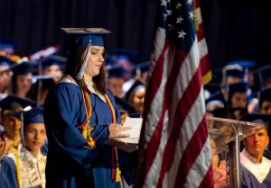 Lewis Mills salutatorian Aubrey Surian prepares to give her speech during graduation Thursday at the Warner Theatre in Torrington. Jim Shannon Republican American