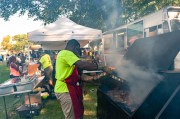 WATERBURY, CT. 30 June 2018-063018BS424 - Ray Bonner of the Caribbean Grill in Derby puts on his special sauce on his jerk chicken during the Fourth Annual Jerk Festival featuring authentic food from the Caribbean at Library Park in Waterbury, CT on Saturday afternoon. Bill Shettle Republican-American