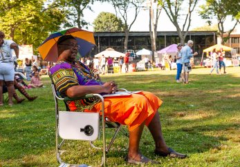 WATERBURY, CT. 30 June 2018-063018BS424 - Eugene Coleman of Waterbury stays cool enjoying the festivities on a very hot day during the Fourth Annual Jerk Festival featuring authentic food from the Caribbean at Library Park in Waterbury, CT on Saturday afternoon. Bill Shettle Republican-American
