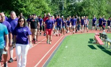 """SOUTHBURY, CT-070818JS14-- Family, friends and supporters make their way around the track during Sunday's """"Walk for Wade"""" event held at Pomperaug High School in Southbury. Wade Prajer, a star athlete at Pomperaug and a criminal justice major at University of New Haven, took his own life on June 3 at the age of 22. The walk was held to honor his life and to help prevent future tragedies. Proceeds from the event will benefit the Alex Archie Foundation. Jim Shannon Republican American"""
