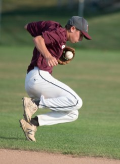 Naugatuck's Corey Plasky (11) recovers after the ball took a bad hop during their Zone 5 American Legion game against Oakville Tuesday at the Taft School in Watertown. Jim Shannon Republican American