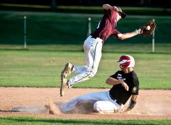 Oakville's Justin Guerrera (22) slides under Naugatuck's Corey Plasky (11) to safely steal second base during their Zone 5 American Legion game Tuesday at the Taft School in Watertown. Jim Shannon Republican American