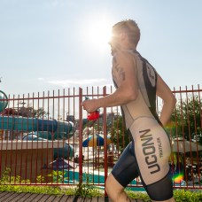 Chris Mulhall runs to the transition area to get on his bike after swimming the half mile swim during the the 32nd annual Pat Griskus Sprint Triathalon at Quassy Amusement Park in Middlebury, CT on Wednesday evening. Bill Shettle Republican-American