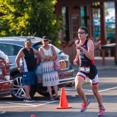 Patrick Daly of Pearl River, NY after biking for 10.5 miles, leads the way in the final leg, during the the 32nd annual Pat Griskus Sprint Triathalon at Quassy Amusement Park in Middlebury, CT on Wednesday evening. Bill Shettle Republican-American