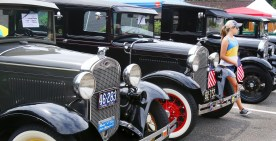 Rilee Bokon, 11, of Cheshire checks out some of the early 1930Õs Model A Fords at the second annual St. Vincent Ferrer Church Car Show in Naugatuck Sunday. Steven Valenti Republican-American