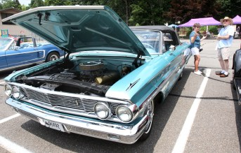 Irene Chabot of Prospect stands near her 1964 Galaxy with Jim Borbas of Prospect at the second annual St. Vincent Ferrer Church Car Show in Naugatuck Sunday. Steven Valenti Republican-American
