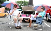 Augie and Margaret Vagnini of Middlebury sit behind their pink 1955 Ford at the second annual St. Vincent Ferrer Church Car Show in Naugatuck Sunday. Steven Valenti Republican-American