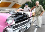 From left, Tony Durante of Watertown and Fred Palomba of Waterbury check out a pink 1955 Ford at the second annual St. Vincent Ferrer Church Car Show in Naugatuck Sunday. Steven Valenti Republican-American