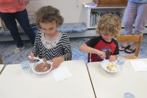 Kaylea and Lucas Wolfe enjoy sundaes at the kickoff for the summer reading program at D.M. Hunt Library in Falls Village. Ruth Epstein Republican-American