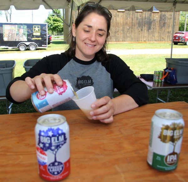 Christine Heaton, brewer at Big Elm Brewing in Sheffield, Mass., pours one of the brewery's beers during the New England Summer Beer Festival at the Goshen Fairgrounds on Saturday. John McKenna Republican-American