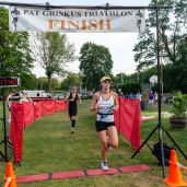 Meaghan Spagnolo, a local girl from Oakville crosses the finish line third overall in the womens division during the the 32nd annual Pat Griskus Sprint Triathalon at Quassy Amusement Park in Middlebury, CT on Wednesday evening. Bill Shettle Republican-American