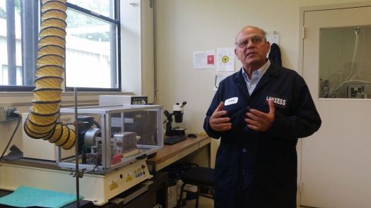 Harrison Connery Republican-AmericanResearch Fellow Frank Deblase demonstrates a high frequency friction machine at Lanxess on Thursday. The machine is used to test the effectiveness of lubricants.