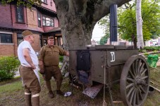 TORRINGTON, CT. 28 July 2018-072818BS10 - Christopher Douglass of Jewett City, left, and Alan Crane of Northford, both re-enactors of the 102nd Regiment Company E 26 Yankee Division, stand next to a exact replica of a Taylor Rolling Kitchen, the only working one in the world during the WW I Living History Day at the Torrington Historical Society in Torrington, CT on Saturday afternoon. Bill Shettle Republican-American
