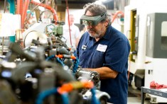 Raymond Suarez, works at a Swiss cam machine on the floor at Palco Connector in Naugatuck, an affiliate of The Phoenix Company of Chicago, Inc., on Friday. Jim Shannon Republican American