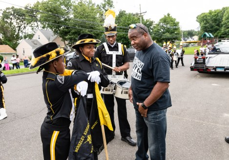 WATERBURY, CT. 20 August 2018-082018 - 25 year veteran Berkeley Knight Drill Master Mike Tripp, right, talks to Berkeley Knight drill team members from left, Tahanya Hillard, Carrizma Gore, and Daren Richards before practicing their World Championship routine in the parking lot of the Berkeley City Recreation Center in Waterbury on Monday evening. Bill Shettle Republican-American